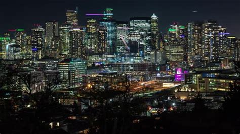 Bright City Skyline Building Lights Timelapse Zoom Out