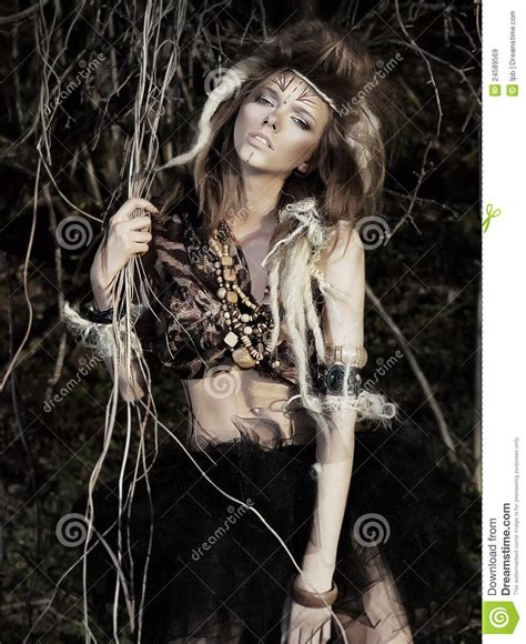 Pretty Tempting Girl With Tattoo Posing In Bushes Stock