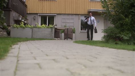 A Man Leaving Home For Work Stock Footage Video 2642852
